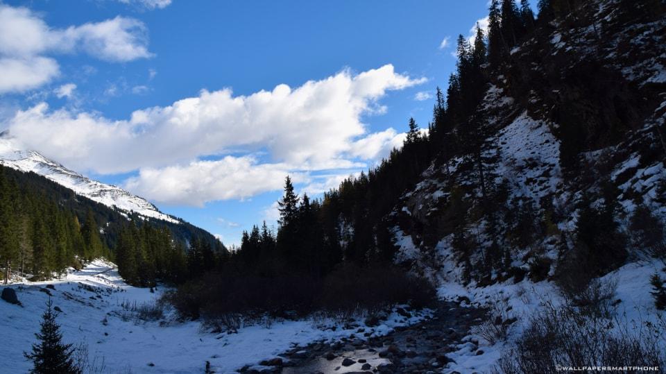 creek between mountains